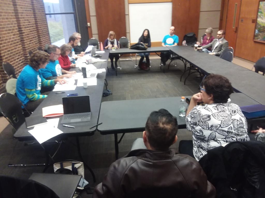 UIC United Faculty members caucus with our bargaining team during a brief break from contract negotiations.