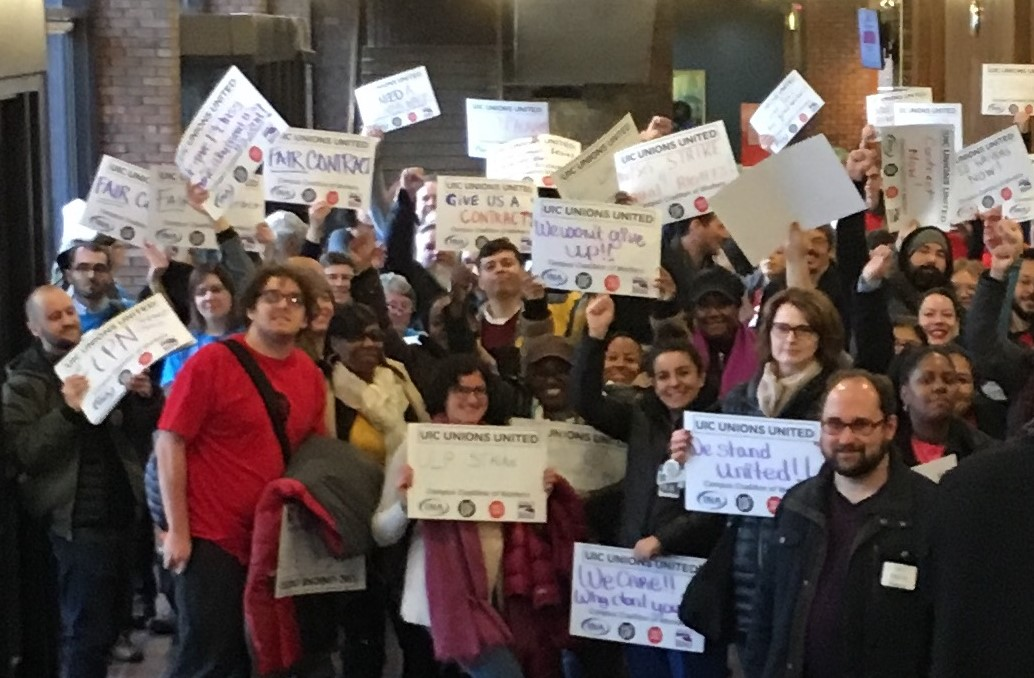 Members of 4 UIC Unions rally against Rauner-Era union busting tactics at the Board of Trustees meeting in Chicago.
