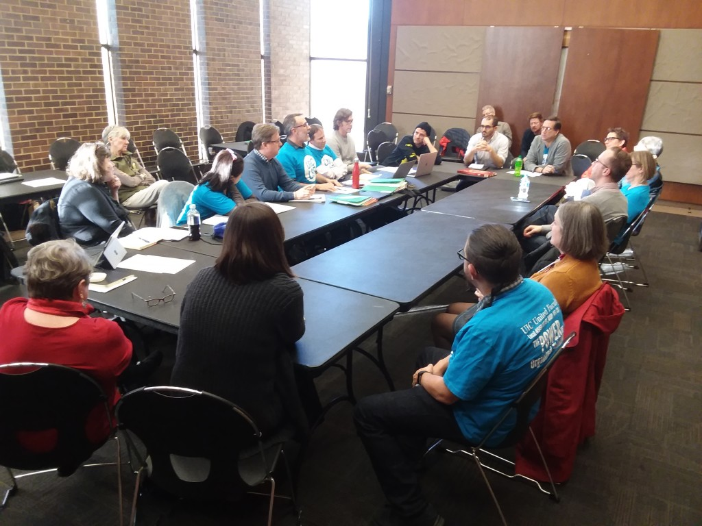 UIC United Faculty's Bargaining Team caucusing with our members during a break in negotiations.